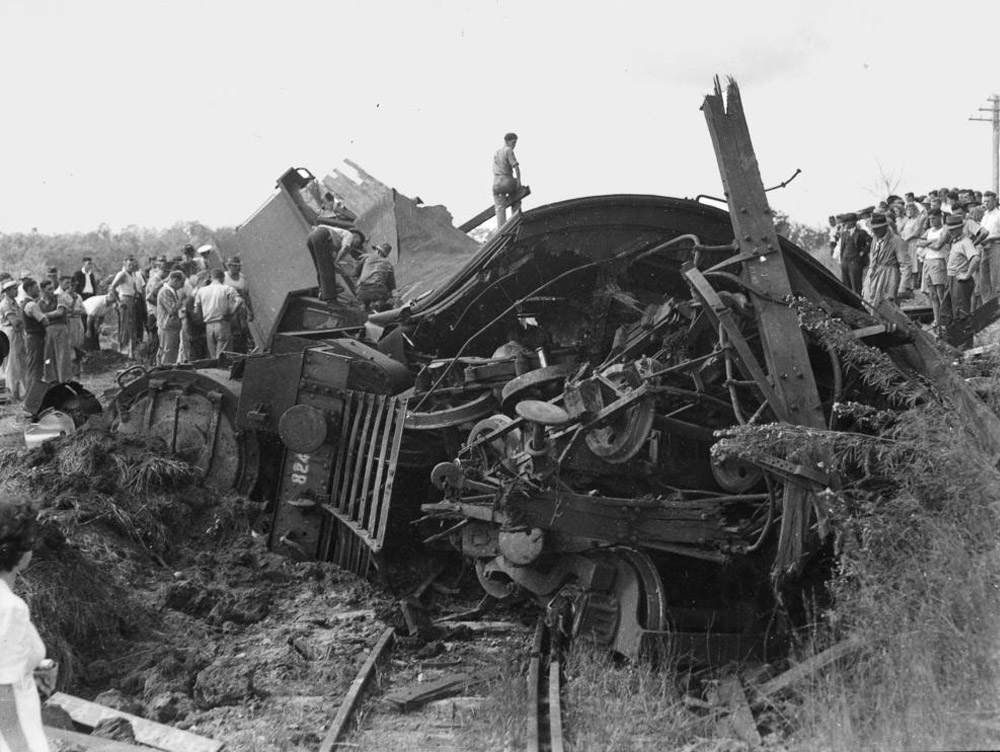 Relief workers inspect engine_SLQ_LR